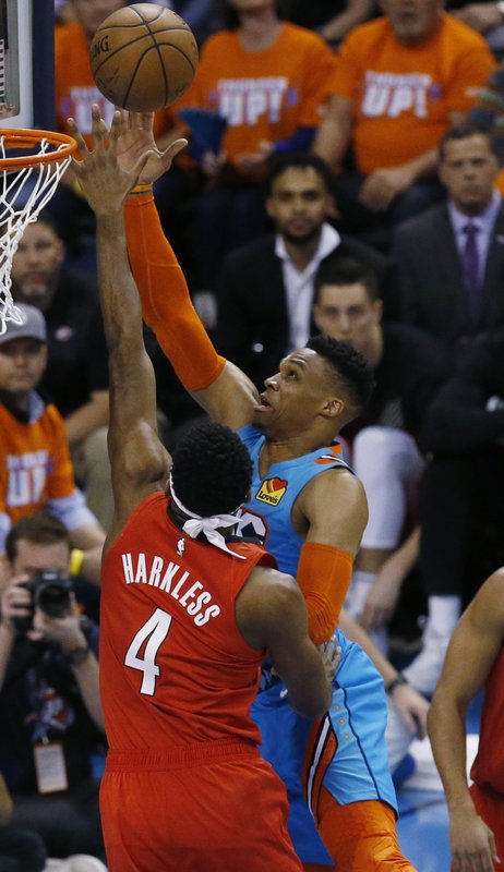 Oklahoma City Thunder guard Russell Westbrook (0) shoots as Portland Trail Blazers forward Maurice Harkless (4) defends in the first half of Game 3 of an NBA basketball first-round playoff series Friday, April 19, 2019, in Oklahoma City. (AP Photo/Sue Ogrocki)