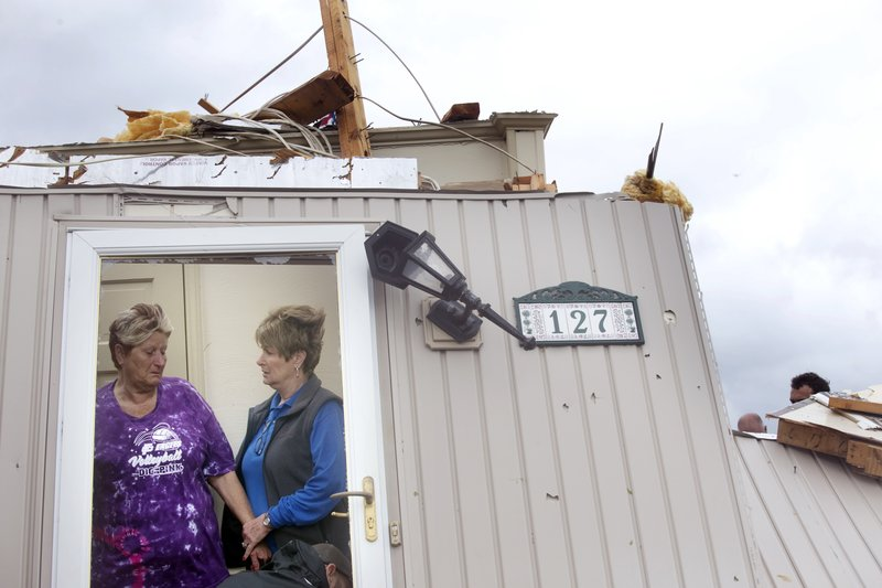 Delores Anderson, left, is comforted by good friend Bea Meeks of Rocky Mount, after her home was destroyed by a tornado Friday, April 19, 2019 on Windy Ridge Road in Franklin County, Va. (Heather Rousseau/The Roanoke Times via AP)