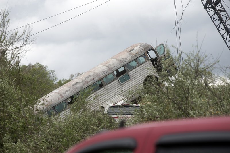 A bus that was taken by a tornado that touched down in Franklin County, Va., is viewed from Fishburn Mountiain Road, Friday, April 19, 2019. (Heather Rousseau/The Roanoke Times via AP)