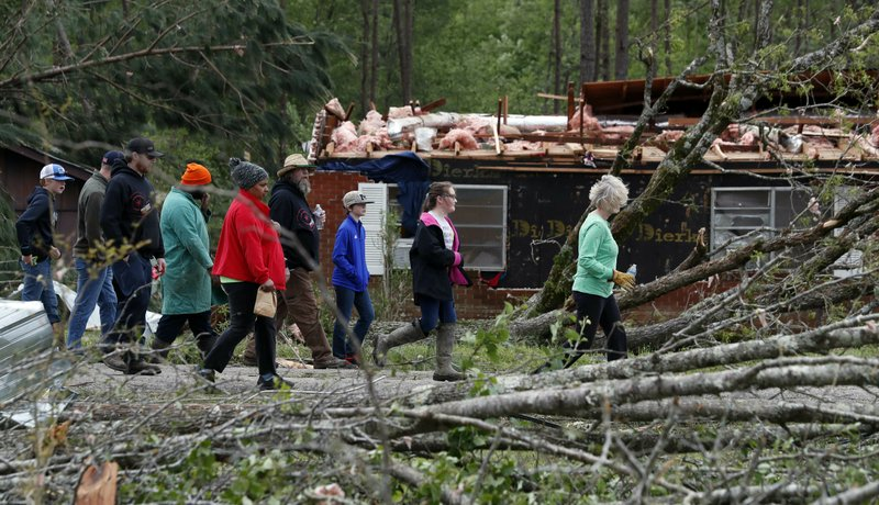 Morton, Miss., residents take a visual tour of their storm damaged neighborhood, Friday, April 19, 2019. (AP Photo/Rogelio V. Solis)