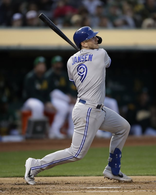 Toronto Blue Jays' Danny Jansen swings for a two-run double off Oakland Athletics' Aaron Brooks in the second inning of a baseball game Friday, April 19, 2019, in Oakland, Calif. (AP Photo/Ben Margot)