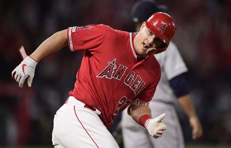 Los Angeles Angels center fielder Mike Trout rounds first after hitting a two-run home run during the eighth inning of a baseball game against the Seattle Mariners on Friday, April 19, 2019, in Anaheim, Calif. (AP Photo/Mark J. Terrill)