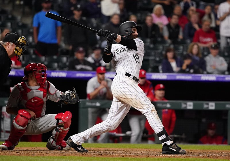 Colorado Rockies' Charlie Blackmon watches his walk-off home run against the Philadelphia Phillies during the 12th inning of a baseball game Friday, April 19, 2019, in Denver. (AP Photo/Jack Dempsey)