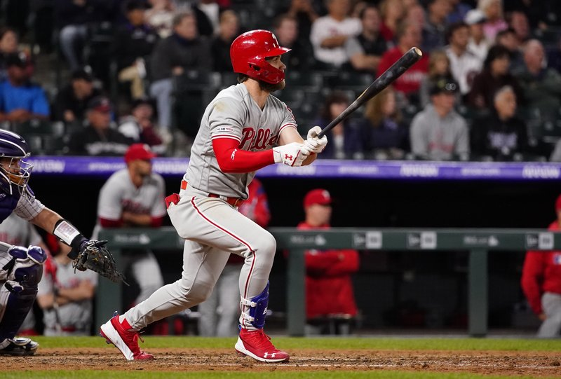 Philadelphia Phillies' Bryce Harper watches his RBI double against the Colorado Rockies during the 12th inning of a baseball game Friday, April 19, 2019, in Denver. (AP Photo/Jack Dempsey)