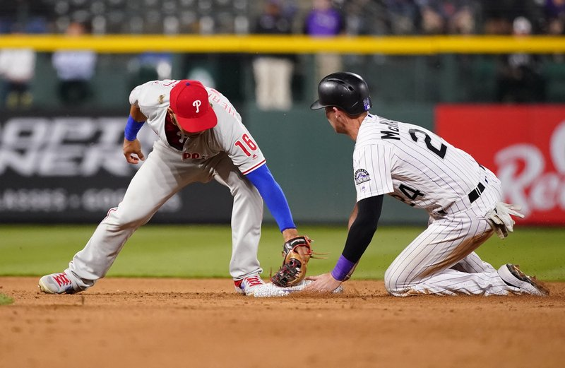 Philadelphia Phillies second baseman Cesar Hernandez (16) is late with the tag, as Colorado Rockies' Ryan McMahon steals second during the 11th inning of a baseball game Friday, April 19, 2019, in Denver. (AP Photo/Jack Dempsey)