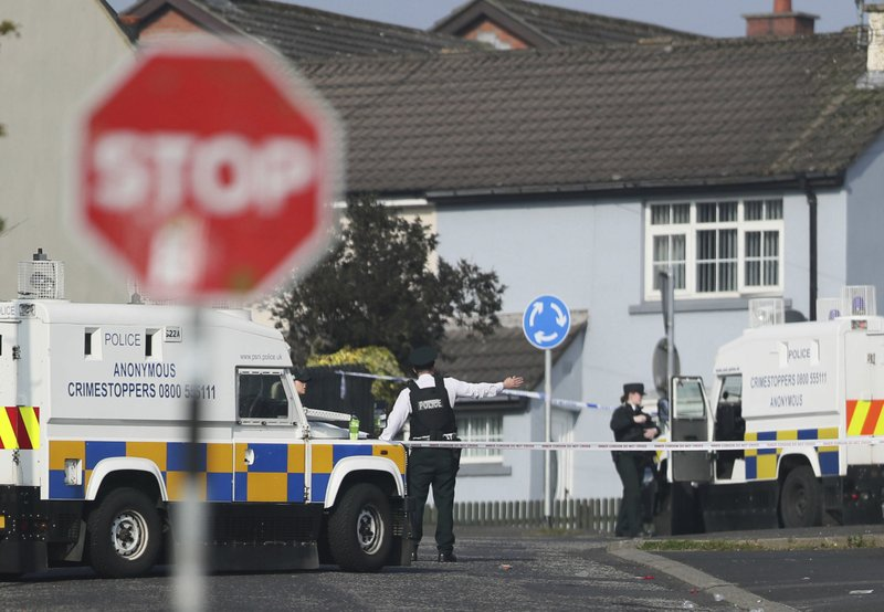 The scene in Londonderry, Northern Ireland, Friday April 19, 2019, following the death of 29-year-old journalist Lyra McKee who was shot and killed during overnight rioting. (Brian Lawless/PA via AP)