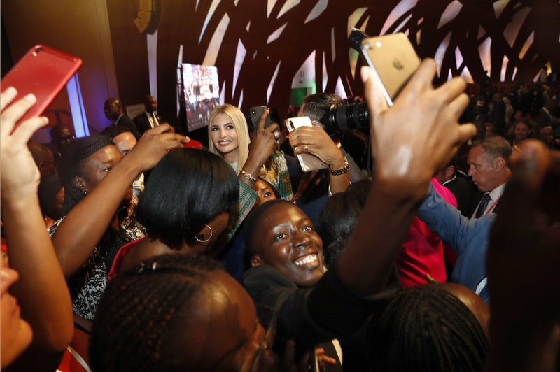 People crowd around U.S. White House senior adviser Ivanka Trump, back left, to take selfies with her at the end of the Women Entrepreneurs Finance Initative, or We-Fi, event sponsored by the World Bank Group, Wednesday, April 17, 2019, in Abidjan, Ivory Coast. (AP Photo/Jacquelyn Martin)