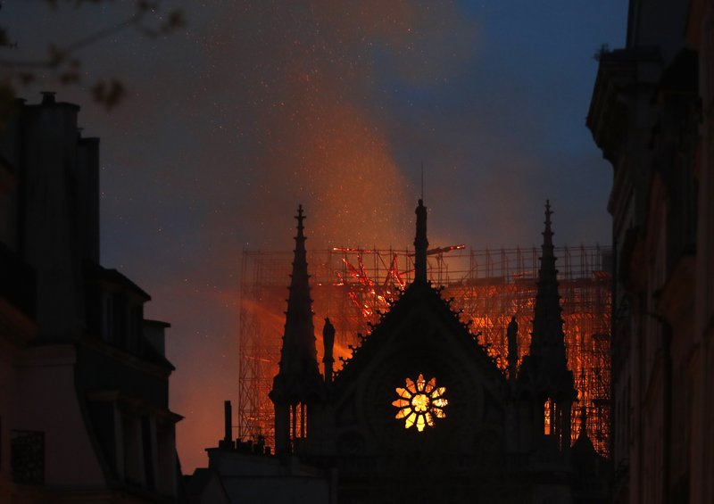 Flames and smoke rise from Notre Dame cathedral in Paris, Monday, April 15, 2019. An inferno that raged through the historic site for more than 12 hours destroyed its spire and its roof but spared its twin medieval bell towers, and a frantic rescue effort saved the monument's