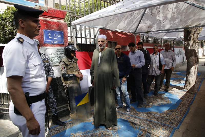 Voters line up to enter a polling station in Cairo, Egypt, Saturday, April 20, 2019. Egyptians are voting on constitutional amendments that would allow el-Sissi to stay in power until 2030. (AP Photo/Amr Nabil)