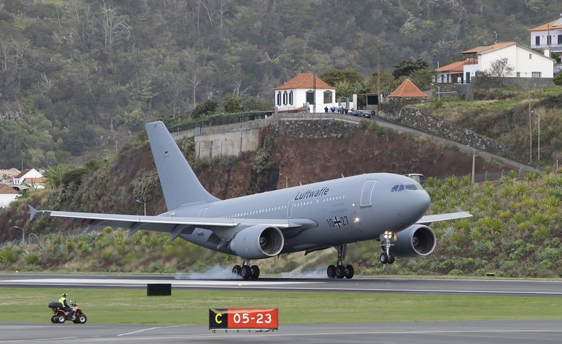A German air force (Luftwaffe) plane lands at Madeira international airport in Funchal, the capital of Portugal's Madeira Island, Saturday April 20, 2019. (AP Photo/Armando Franca)