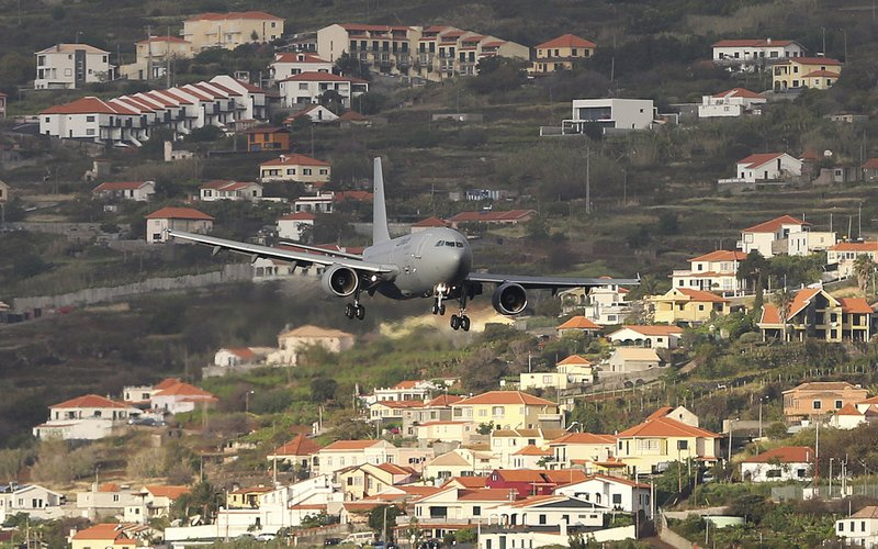 A German air force (Luftwaffe) plane comes into land at Madeira international airport in Funchal, the capital of Portugal's Madeira Island, Saturday April 20, 2019. (AP Photo/Armando Franca)