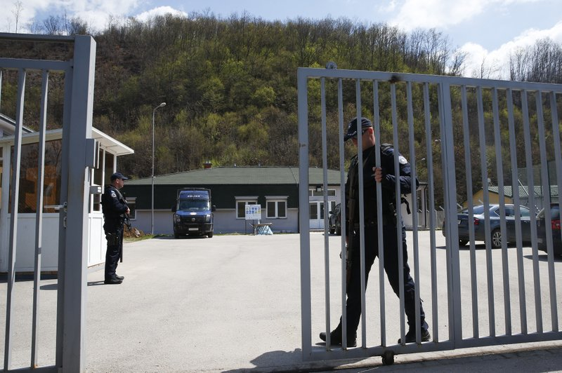 Kosovo police officer secures the area of a detention center where authorities brought back from Syria 110 Kosovar citizens, mostly women and children in the village of Vranidol on Sunday, April 20, 2019. (AP Photo/Visar Kryeziu)