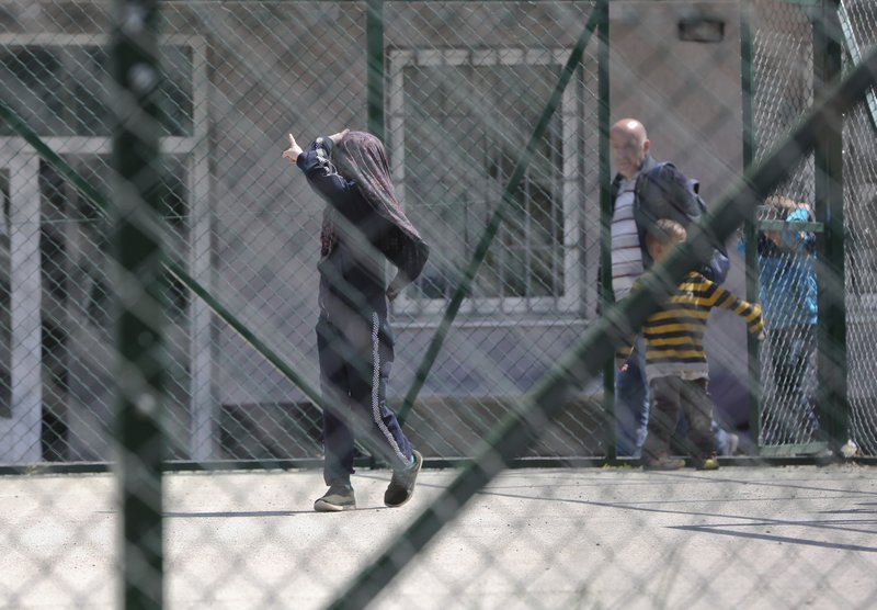 Group of children walk at a detention center where authorities have brought back from Syria 110 Kosovar citizens, mostly women and children in the village of Vranidol on Sunday, April 20, 2019. (AP Photo/Visar Kryeziu)
