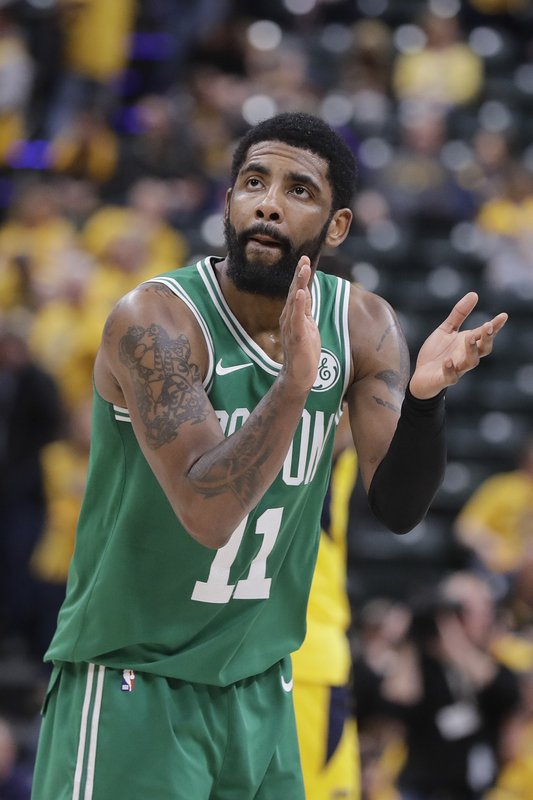 Boston Celtics' Kyrie Irving reacts during the second half of Game 3 of the team's NBA basketball first-round playoff series against the Indiana Pacers, Friday, April 19, 2019, in Indianapolis. (AP Photo/Darron Cummings)