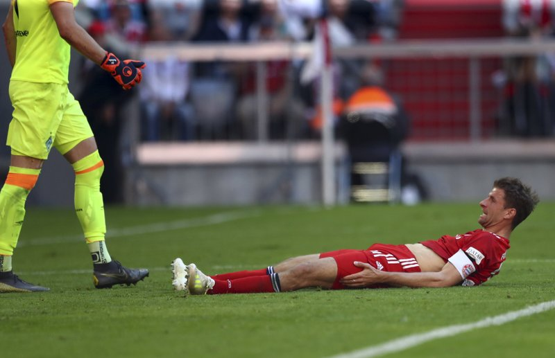 Bayern forward Thomas Mueller lays on the ground after missing a chance during the German Bundesliga soccer match between Bayern Munich and Werder Bremen at the Allianz Arena in Munich, Germany, Saturday, April 20, 2019. (AP Photo/Matthias Schrader)