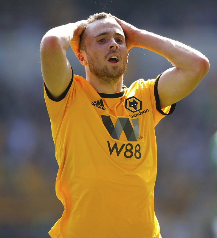 Wolverhampton Wanderers' Diogo Jota reacts during the English Premier League soccer match between Wolverhampton Wanders and Brighton and Hove Albion at the Molineux stadium, Wolverhampton, England. (Nick Potts/PA via AP)
