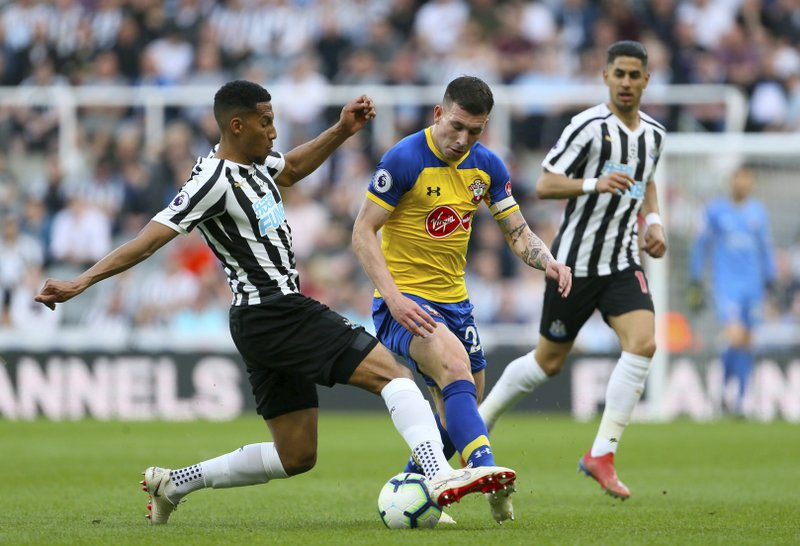 Newcastle United's Isaac Hayden, left, and Southampton's Pierre-Emile Hojbjerg, during their English Premier League soccer match at St James' Park in Newcastle, England, Saturday April 20, 2019. (Richard Sellers/PA via AP)