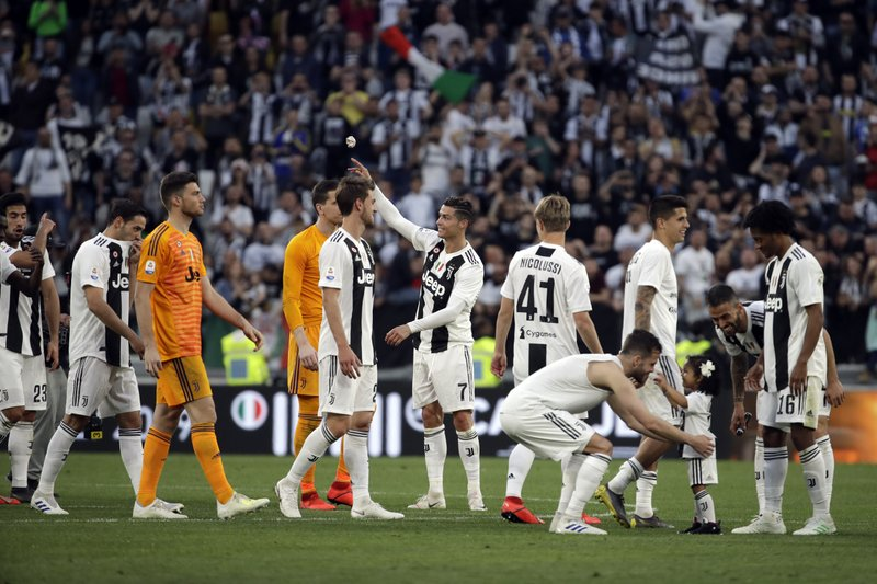 Juventus players celebrate at the end of a Serie A soccer match between Juventus and AC Fiorentina, at the Allianz stadium in Turin, Italy, Saturday, April 20, 2019. (AP Photo/Luca Bruno)
