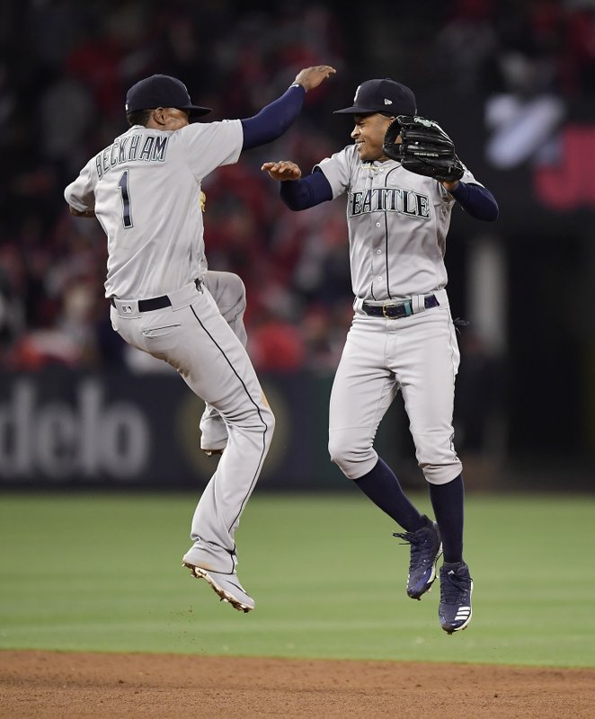 Seattle Mariners' Tim Beckham, left, and Mallex Smith celebrate after the Mariners defeated the Los Angeles Angels 5-3 in a baseball game Friday, April 19, 2019, in Anaheim, Calif. (AP Photo/Mark J. Terrill)