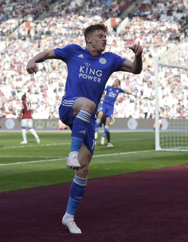 Leicester City's Harvey Barnes leaps as he celebrates after scoring his sides 2nd goal of the game during the English Premier League soccer match between West Ham and Leicester City at the London stadium in London, Saturday, April 20, 2019. (AP Photo/Kirsty Wigglesworth)