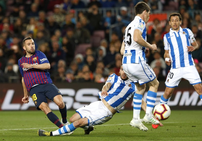 Barcelona defender Jordi Alba scores his side's 2nd goal during a Spanish La Liga soccer match between FC Barcelona and Real Sociedad at the Camp Nou stadium in Barcelona, Spain, Saturday, April 20, 2019. (AP Photo/Joan Monfort)