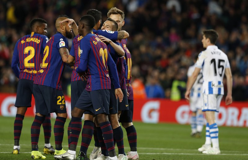 Barcelona defender Jordi Alba, right, celebrates with teammates scoring his side's 2nd goal during a Spanish La Liga soccer match between FC Barcelona and Real Sociedad at the Camp Nou stadium in Barcelona, Spain, Saturday, April 20, 2019. (AP Photo/Joan Monfort)