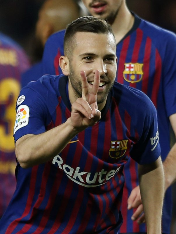 Barcelona defender Jordi Alba celebrates scoring his side's 2nd goal during a Spanish La Liga soccer match between FC Barcelona and Real Sociedad at the Camp Nou stadium in Barcelona, Spain, Saturday, April 20, 2019. (AP Photo/Joan Monfort)
