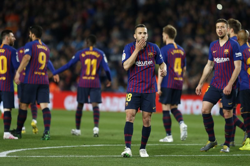 Barcelona defender Jordi Alba, centre, celebrates scoring his side's 2nd goal during a Spanish La Liga soccer match between FC Barcelona and Real Sociedad at the Camp Nou stadium in Barcelona, Spain, Saturday, April 20, 2019. (AP Photo/Joan Monfort)
