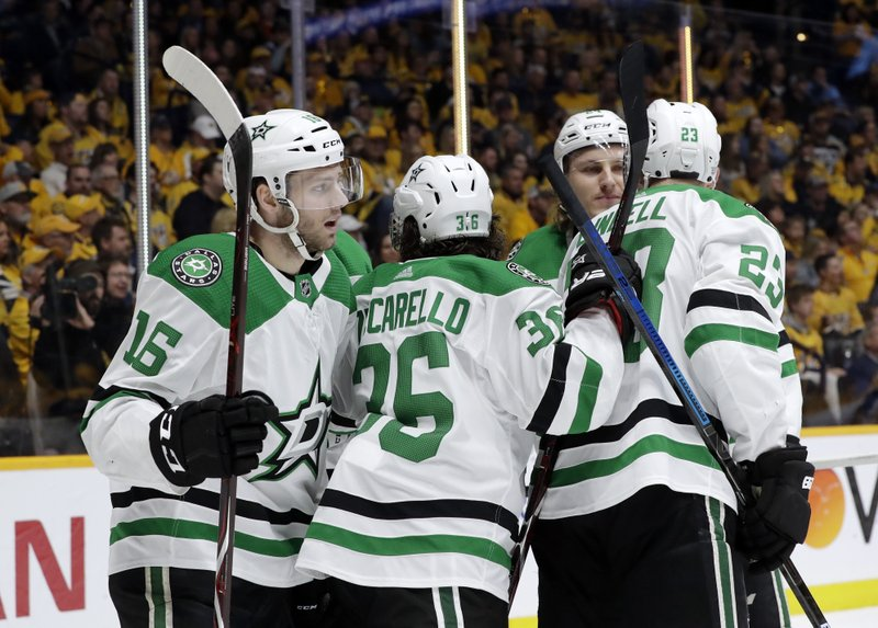 Dallas Stars center Jason Dickinson (16) celebrates with Matts Zuccarello (36), of Norway, and Esa Lindell (23), of Finland, after Dickinson scored a goal against the Nashville Predators during the first period in Game 5 of an NHL hockey first-round playoff series Saturday, April 20, 2019, in Nashville, Tenn. (AP Photo/Mark Humphrey)
