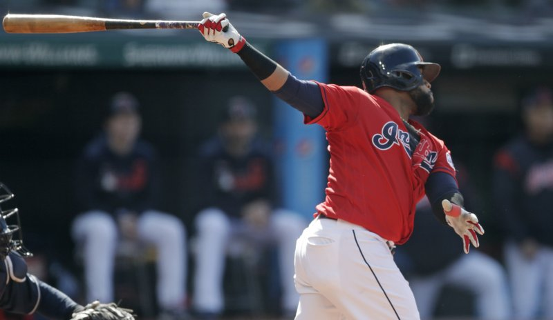 Cleveland Indians' Carlos Santana watches his RBI-single off Atlanta Braves starting pitcher Julio Teheran in the first inning during the first game of a baseball doubleheader, Saturday, April 20, 2019, in Cleveland. (AP Photo/Tony Dejak)