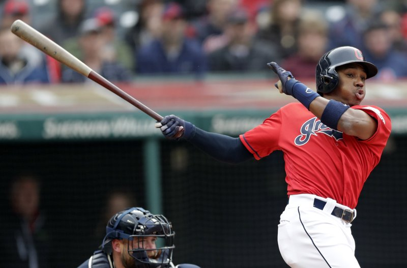 Cleveland Indians' Greg Allen, right, hits a one-run double off Atlanta Braves starting pitcher Julio Teheran in the fifth inning during the first game of a baseball doubleheader, Saturday, April 20, 2019, in Cleveland. (AP Photo/Tony Dejak)