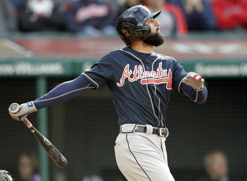 Atlanta Braves' Nick Markakis watches his ball after hitting a sacrifice fly off Cleveland Indians starting pitcher Corey Kluber in the third inning during the first game of a baseball doubleheader, Saturday, April 20, 2019, in Cleveland. (AP Photo/Tony Dejak)