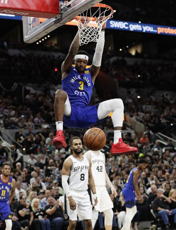 Denver Nuggets forward Torrey Craig (3) scores against the San Antonio Spurs during the first half of Game 4 of an NBA basketball playoff series in San Antonio, Saturday, April 20, 2019. (AP Photo/Eric Gay)