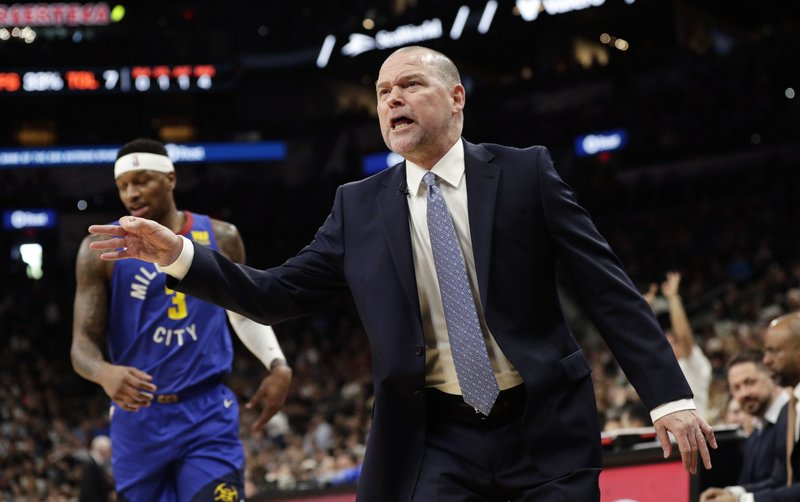 Denver Nuggets head coach Michael Malone argues a call during the first half of Game 4 of an NBA basketball playoff series against San Antonio Spurs in San Antonio, Saturday, April 20, 2019. (AP Photo/Eric Gay)