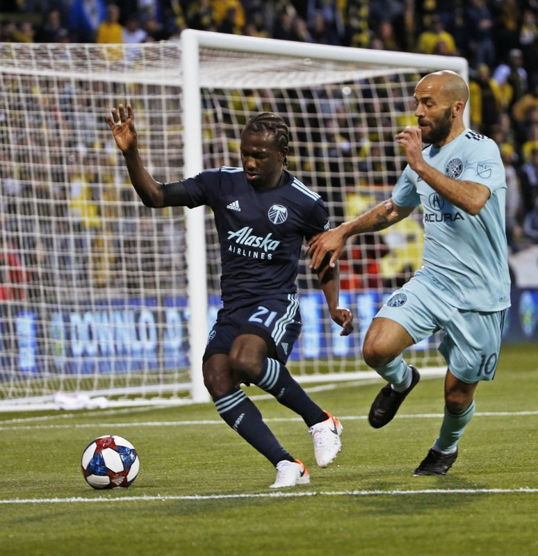 Portland Timbers midfielder Diego Chara (21) tries to keep the ball against Columbus Crew forward Federico Higuain (10) in the first half of an MLS soccer game in Columbus, Ohio, Saturday, April 20, 2019. (Eric Albrecht/The Columbus Dispatch via AP)