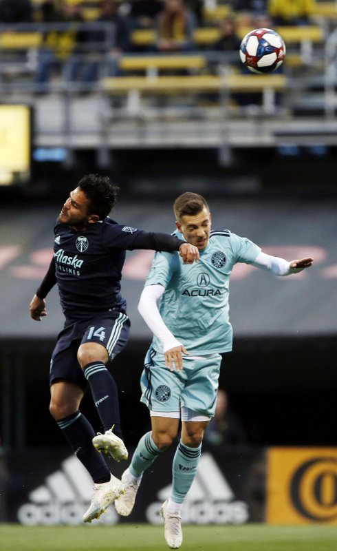 Columbus Crew forward Pedro Santos (7) goes up against Portland Timbers midfielder Andres Flores (14) in the first half of an MLS soccer game in Columbus, Ohio, Saturday, April 20, 2019. (Eric Albrecht/The Columbus Dispatch via AP)