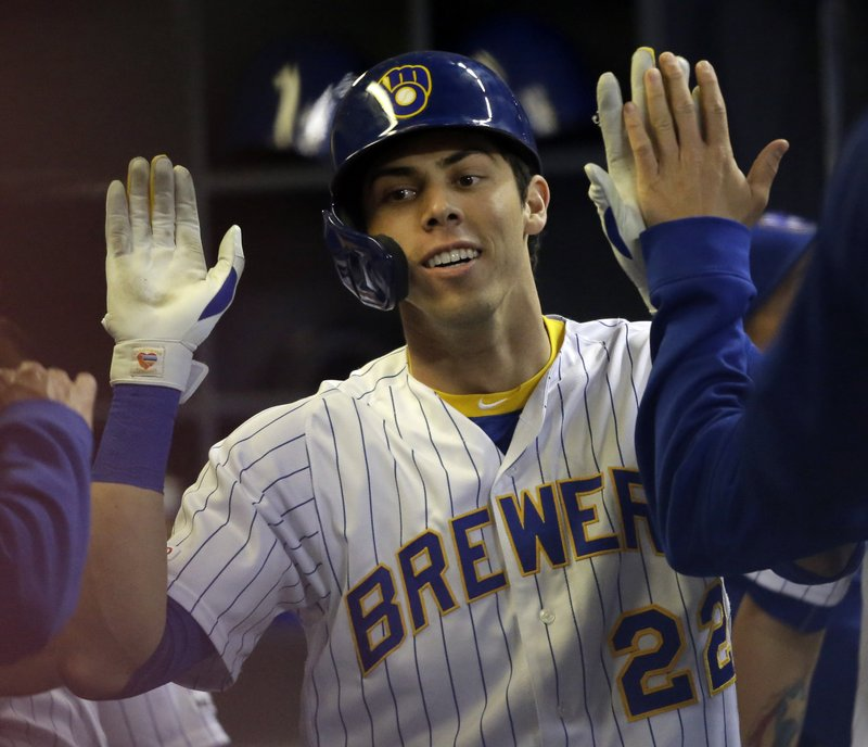 Milwaukee Brewers' Christian Yelich reacts in the dugout after hitting a home run against the Los Angeles Dodgers during the sixth inning of a baseball game Saturday, April 20, 2019, in Milwaukee. (AP Photo/Jeffrey Phelps)
