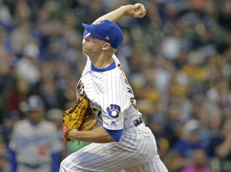 Milwaukee Brewers starting pitcher Chase Anderson throws to the Los Angeles Dodgers during the first inning of a baseball game Saturday, April 20, 2019, in Milwaukee. (AP Photo/Jeffrey Phelps)