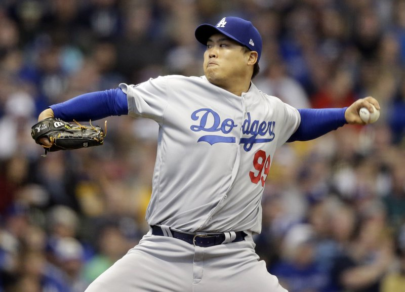 Los Angeles Dodgers starting pitcher Hyun-Jin Ryu throws to the Milwaukee Brewers during the first inning of a baseball game Saturday, April 20, 2019, in Milwaukee. (AP Photo/Jeffrey Phelps)