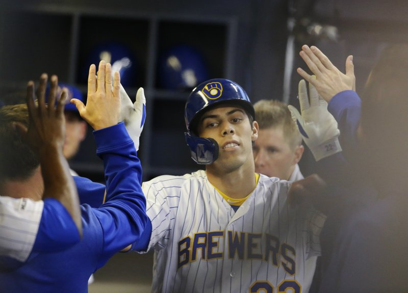 Milwaukee Brewers' Christian Yelich reacts in the dugout after his home run against the Los Angeles Dodgers during the third inning of a baseball game Saturday, April 20, 2019, in Milwaukee. (AP Photo/Jeffrey Phelps)