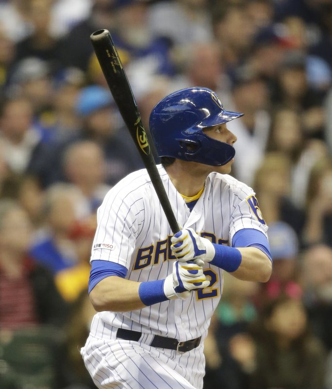 Milwaukee Brewers' Christian Yelich watches his home run against the Los Angeles Dodgers during the third inning of a baseball game Saturday, April 20, 2019, in Milwaukee. (AP Photo/Jeffrey Phelps)