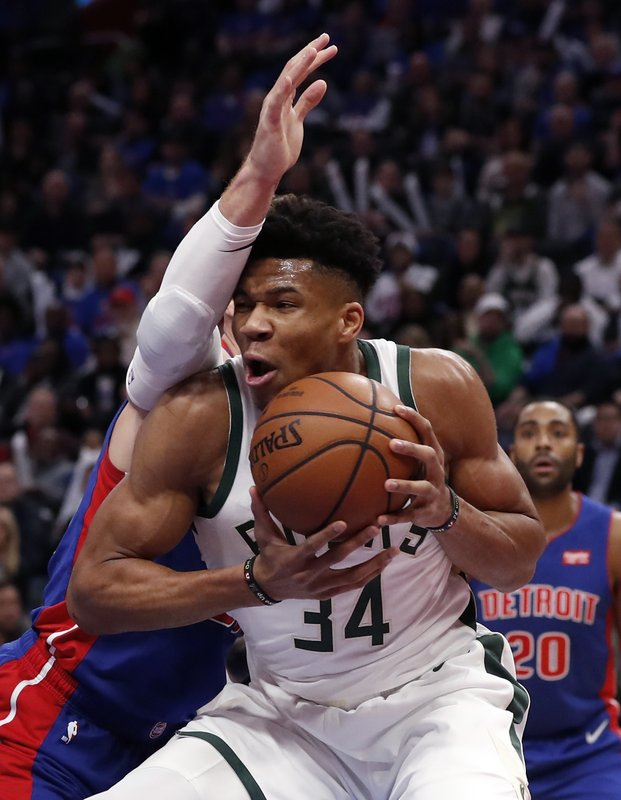 Milwaukee Bucks forward Giannis Antetokounmpo (34) is defended by Detroit Pistons forward Blake Griffin during the first half of Game 3 of a first-round NBA basketball playoff series, Saturday, April 20, 2019, in Detroit. (AP Photo/Carlos Osorio)