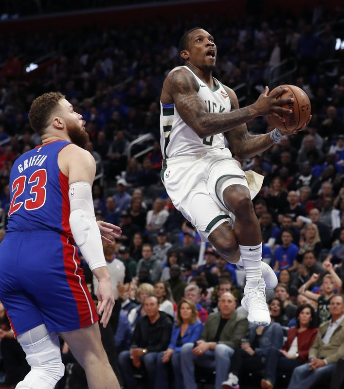 Milwaukee Bucks guard Eric Bledsoe, right, makes a layup as Detroit Pistons forward Blake Griffin (23) watches during the first half of Game 3 of a first-round NBA basketball playoff series, Saturday, April 20, 2019, in Detroit. (AP Photo/Carlos Osorio)