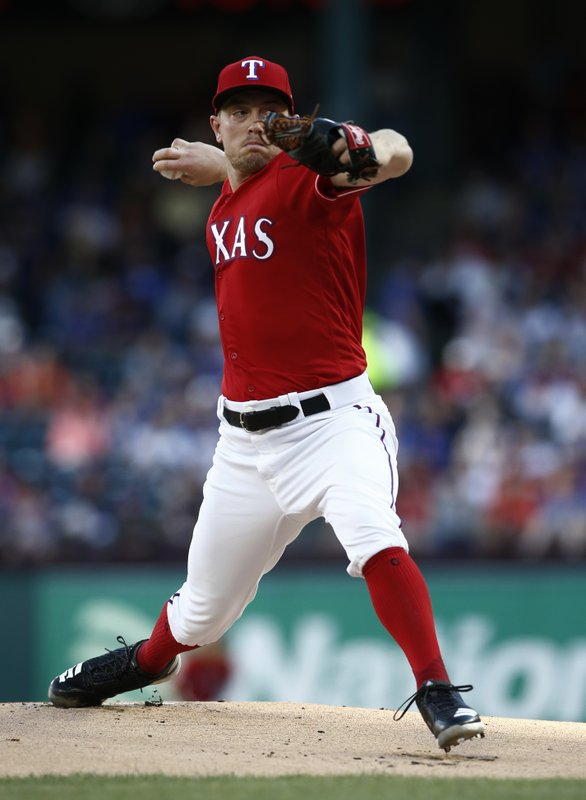 CORRECTS TO APRIL 20 NOT APRIL 19 - Texas Rangers starting pitcher Adrian Sampson delivers against the Houston Astros during the first inning of a baseball game Saturday, April 20, 2019, in Arlington, Texas. (AP Photo/Mike Stone)