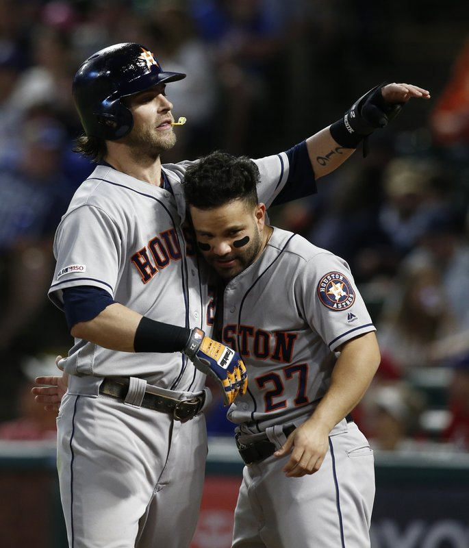 Houston Astros' Josh Reddickcelebrates with Jose Altuve (27) after he scored on a home run hit by Max Stassi against the Texas Rangers during the fifth inning of a baseball game Saturday, April 20, 2019, in Arlington, Texas. (AP Photo/Mike Stone)