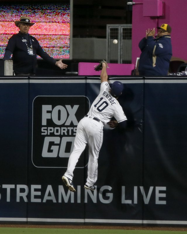 San Diego Padres right fielder Hunter Renfroe leaps but cannot reach a solo home run hit by Cincinnati Reds' Jesse Winker during the seventh inning of a baseball game in San Diego, Saturday, April 20, 2019. (AP Photo/Alex Gallardo)