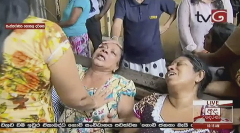 This image made from video, released by Derena TV shows women in despair after an explosion in Colombo, Sunday, April 21, 2019. (Derena TV via AP)