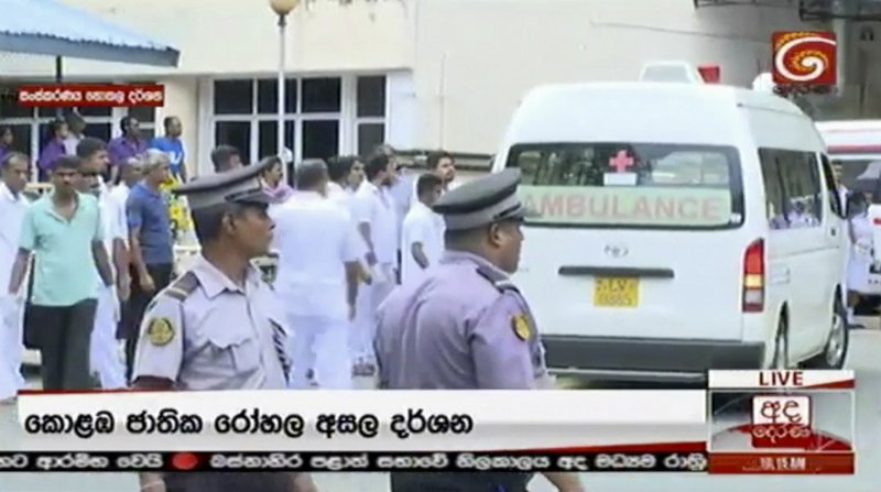 This image made from video, released by Derena TV shows police and emergency services at one of the blast sites in Colombo, Sunday, April 21, 2019. (Derena TV via AP)