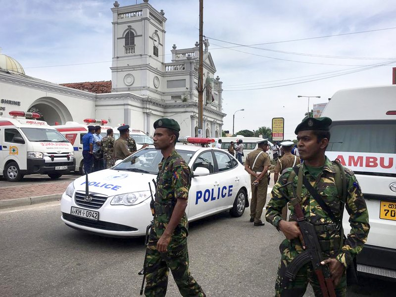 ADDS THE NAME OF CHURCH - Sri Lankan Army soldiers secure the area around St. Anthony's Shrine after a blast in Colombo, Sri Lanka, Sunday, April 21, 2019. (AP Photo/Eranga Jayawardena)