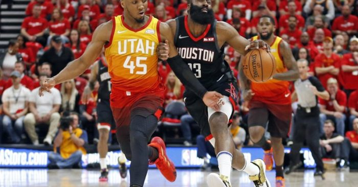 3e77301761e Utah Jazz guard Donovan Mitchell (45) defends against Houston Rockets guard  James Harden (13) as he drives up court in the first half during an NBA ...